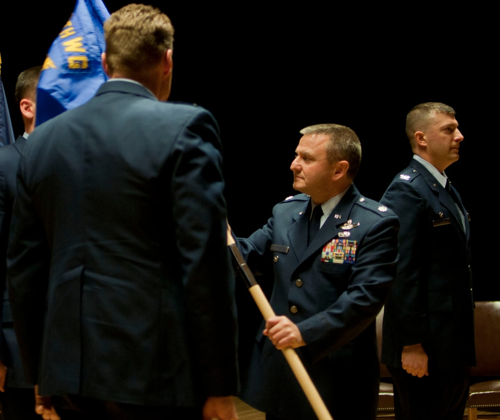 JOINT BASE ELMENDORF-RICHARDSON, Alaska -- Lt.Col. Michael Griesbaum accepts the 176th Maintenance Group flag signifying his new position as commander during a ceremony here Dec. 6, 2014. U.S. Air National Guard photo by Staff Sgt N. Alicia Halla/ Released