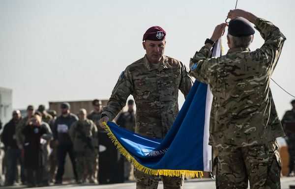 Army Lt. Gen. Joseph Anderson, commander of International Security Assistance Force Joint Command, and Royal Army Maj. Gen. Richard Nugee, ISAF chief of staff, lower the ISAF Joint Command colors at Kabul International Airport, Afghanistan, during a casing ceremony marking the end of the ISAF Joint Command mission, Dec. 8, 2014 U.S. Air Force photo by Staff Sgt. Perry Aston