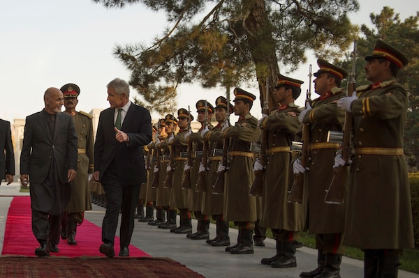 Afghan President Mohammad Ashraf Ghani welcomes Defense Secretary Chuck Hagel with an honor cordon at the presidential palace in Kabul, Afghanistan, Dec. 6, 2014. DoD photo by Air Force Master Sgt. Adrian Cadiz