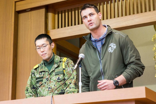 U.S. Marine Staff Sgt. Ryan T. Watson speaks to students Dec. 5 at Chinzei High School in Kumamoto prefecture, Japan. Marines participating in Forest Light 15-1 took a day off from training to visit local high schools to exchange culture lessons with the students. Forest Light is a routine, semi-annual exercise designed to enhance the U.S. and Japan military partnership, solidify regional security agreements, and improve individual and unit-level skills in a bilateral training environment. Watson, from Tulsa, Oklahoma, is an infantry unit leader with 2nd Battalion, 9th Marine Regiment, currently assigned to 4th Marine Regiment, 3rd Marine Division, III Marine Expeditionary Force, under the unit deployment program.