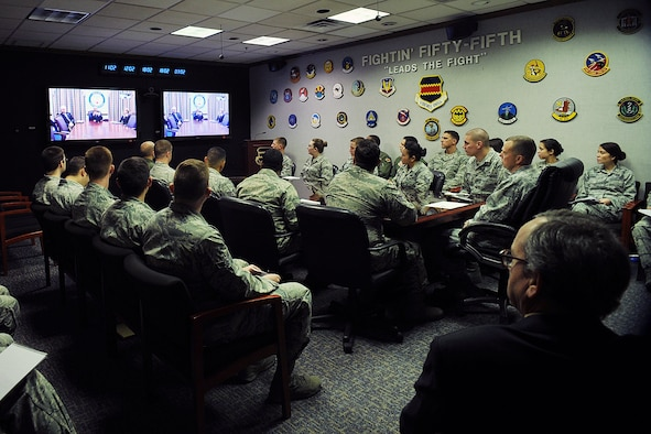 More than 30 members of the 55th Wing listen to Air Force Vice Chief of Staff Gen. Larry Spencer as he discusses the Airman Powered by Innovation program during a virtual town hall meeting Dec. 1, 2014, at Offutt Air Force Base, Neb. Offutt is the first base chosen to interact with the vice chief on the topic and he hopes that by spreading the word on this program Airmen will submit ideas that will transform the way the Air Force does business. (U.S. Air Force photo/Charles Haymond)