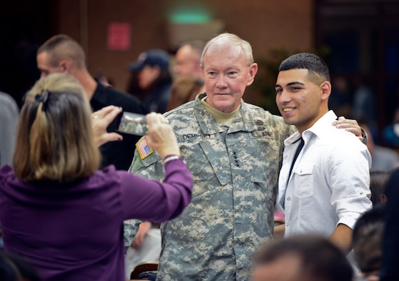 The Chairman of the Joint Chiefs of Staff, Army Gen. Martin E. Dempsey, takes a picture with an Airman during a USO holiday troop visit Dec. 8, 2014, at Incirlik Air Base, Turkey. Dempsey is on his final holiday troop visit tour visiting with Airmen serving abroad. (U.S. Air Force photo/Airman Cory W. Bush)