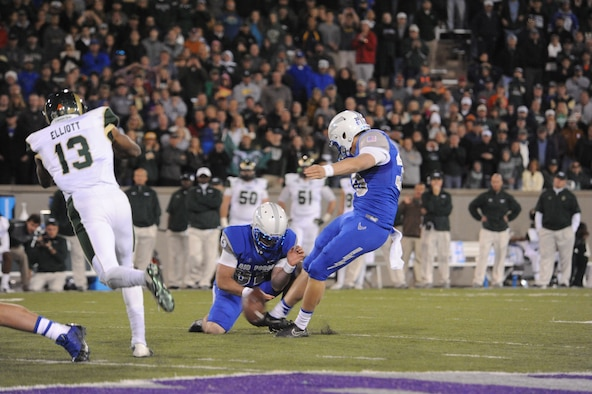 Air Force Falcons kicker/punter, Will Conant, kicks a 39-yard field goal in the last second of the Air Force vs. Colorado State University game at Falcon Stadium Nov. 28, 2014. The Falcons won 27-24. The win kept Air Force undefeated at home and closes out the Falcons' regular season at 9-3. (U.S. Air Force photo/John Van Winkle)