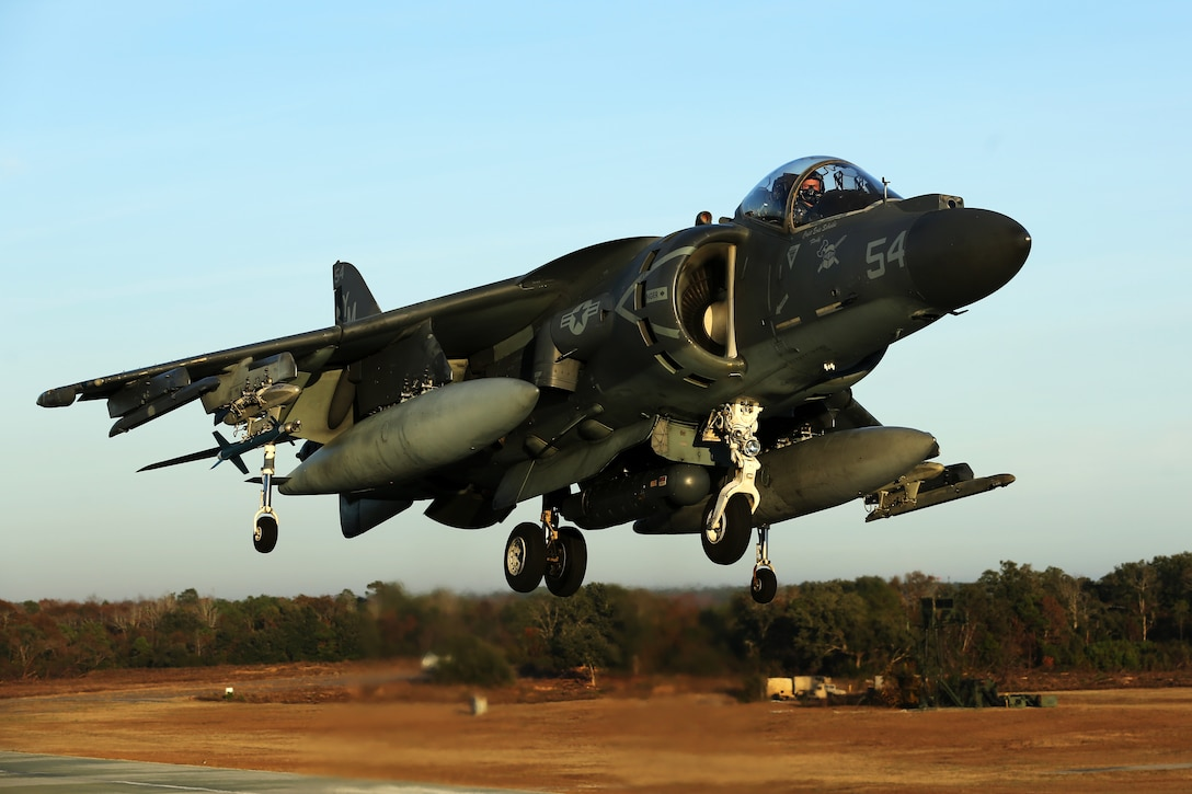 Maj. James S. Tanis lands an AV-8B Harrier during field carrier landing practice sustainment training at Marine Corps Auxiliary Landing Field Bogue, N.C., Dec. 5, 2014. Marine Attack Squadron 231 is slated to deploy with Marine Medium Tiltrotor Squadron 365 (Reinforced) during an upcoming deployment with the 24th Marine Expeditionary Unit. Tanis is a naval aviator and executive officer of VMM-365 (Rein).