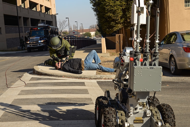 Staff Sgt. Quentin Tubbs, 51st Civil Engineer Squadron Explosive Ordnance Disposal, inspects a simulated IED during a scenario for Beverly Bulldog 15-01 Dec. 9, 2014, at Osan Air Base, Republic of Korea. Beverly Bulldog 15-01 is a peninsula-wide ORE designed to test American forces mission readiness in the event of an emergency or wartime environment.(U.S. Air Force photo by Staff Sgt. Jake Barreiro)