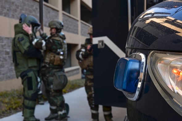 Staff Sgt. Quentin Tubbs, 51st Civil Engineer Squadron Explosive Ordnance Disposal, dons a protective suit during an IED diffusal scenario for exercise Beverly Bulldog 15-01 Dec. 9, 2014, at Osan Air Base, Republic of Korea. Beverly Bulldog 15-1 is a peninsula-wide ORE designed to test American forces mission readiness in the event of an emergency or wartime environment. (U.S. Air Force photo by Staff Sgt. Jake Barreiro)