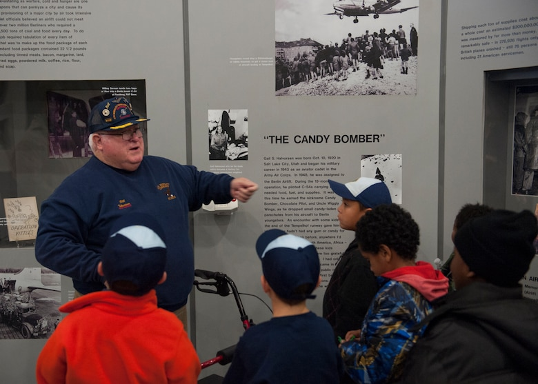 Bill Maroon, volunteer tour guide, gives a guided tour to a group of Boy Scouts Nov. 15, 2014, at the AMC Museum on Dover Air Force Base, Del. Maroon is one of 170 volunteers who work at the museum. (U.S. Air Force photo/Airman 1st Class Zachary Cacicia)