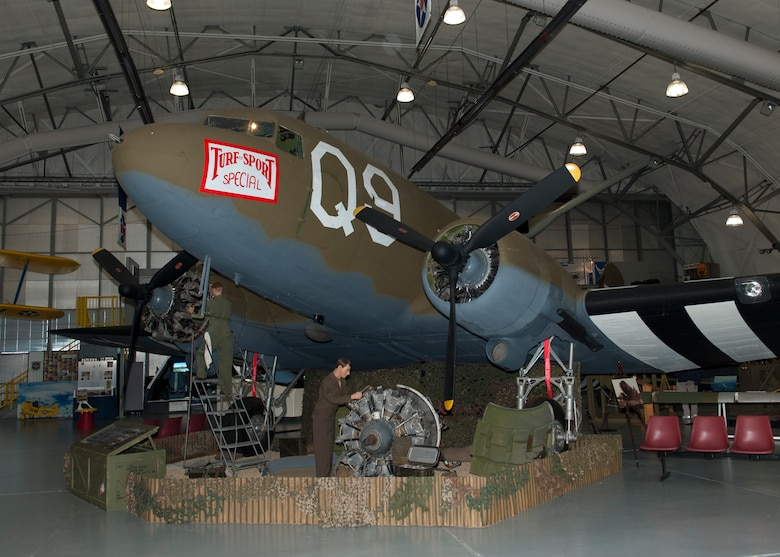 "The C-47A Skytrain, ""Turf and Sport Special,"" prominently sits on display Nov. 15, 2014, inside the Air Mobility Command Museum on Dover Air Force Base, Del. This aircraft saw action on D-Day, the invasion of Normandy, dropping paratroopers from the 82nd Airborne Division into St. Mere-Eglise, France. (U.S. Air Force photo/Airman 1st Class Zachary Cacicia)"