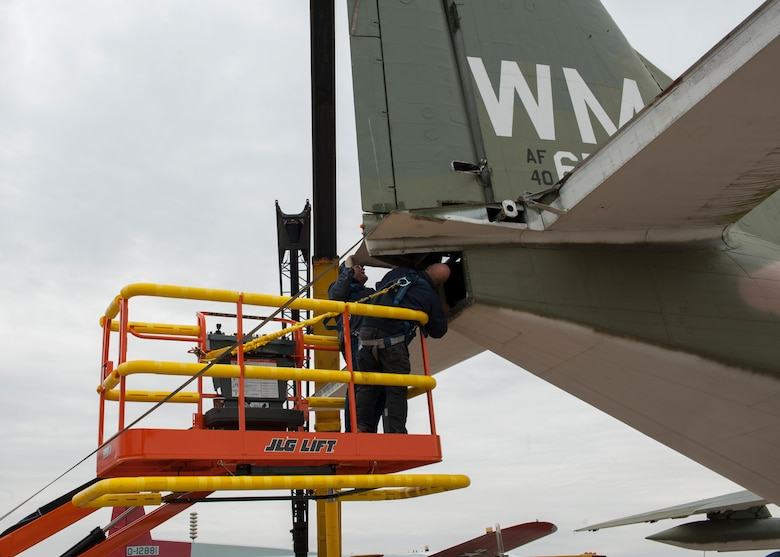 Leslie Polley, restoration manager, and Gene Somma, restoration volunteer, detach a rudder from the vertical stabilizer of a C-123K Provider cargo aircraft Nov. 13, 2014, at the Air Mobility Command Museum, on Dover Air Force Base, Del. The AMC Museum's restoration crew is comprised of an all-volunteer staff. (U.S. Air Force photo/Airman 1st Class Zachary Cacicia)