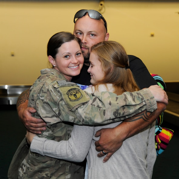 Oregon Staff Sgt. Alicia Tishmack, an emergency management specialist assigned to the 142nd Fighter Wing Civil Engineer Squadron is greeted by family members at the Portland International Airport, Oct. 10, 2014, after returning from deployment in support of Operation Enduring Freedom. (U.S. Air National Guard photo by Tech. Sgt. John Hughel, 142nd Fighter Wing Public Affairs/Released)