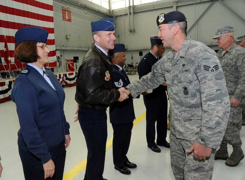 Col. Rick Wedan, 142nd Fighter Wing Commander, center left, along with Chief Master Sgt. Julie Eddings, 142nd Fighter Wing Command Chief, left, greet Airmen from the 142nd Fighter Wing Civil Engineer Squadron and Security Forces Squadron after the formal Demobilization Ceremony at the Portland Air National Guard Base, Ore., Dec. 7, 2014. (U.S. Air National Guard photo by Tech. Sgt. John Hughel, 142nd Fighter Wing Public Affairs/Released)
