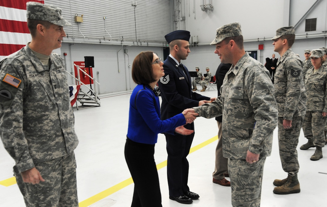 Kate Brown, Oregon Sec. of State, greets Lt. Col. Jason Lay, 142nd Fighter Wing Civil Engineer Squadron Commander and Security Forces Squadron Airmen after the formal Demobilization Ceremony at the Portland Air National Guard Base, Ore., Dec. 7, 2014. (U.S. Air National Guard photo by Tech. Sgt. John Hughel, 142nd Fighter Wing Public Affairs/Released)