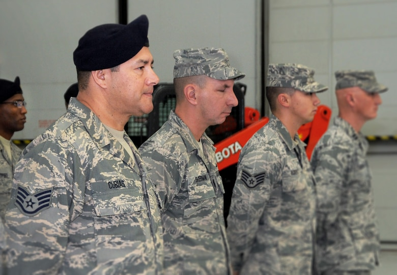 Oregon Staff Sgt. Joseph Cubias, assigned to the 142nd Fighter Wing Security Forces Squadron, stands in formation and listens to remarks during the Demobilization Ceremony for the 142nd Fighter Wing Civil Engineer Squadron and Security Forces Squadron at the Portland Air National Guard Base, Ore., Dec. 7, 2014. (U.S. Air National Guard photo by Tech. Sgt. John Hughel, 142nd Fighter Wing Public Affairs/Released)