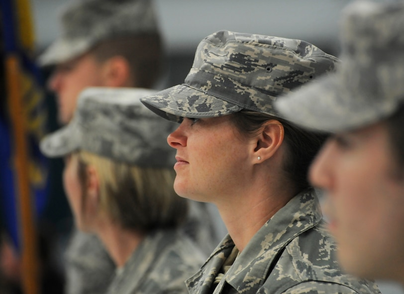 Oregon Staff Sgt. Alicia Tishmack, assigned to the 142nd Fighter Wing Civil Engineer Squadron, stands in formation and listens to remarks during the Demobilization Ceremony for the 142nd Fighter Wing Civil Engineer Squadron and Security Forces Squadron at the Portland Air National Guard Base, Ore., Dec. 7, 2014. (U.S. Air National Guard photo by Tech. Sgt. John Hughel, 142nd Fighter Wing Public Affairs/Released)