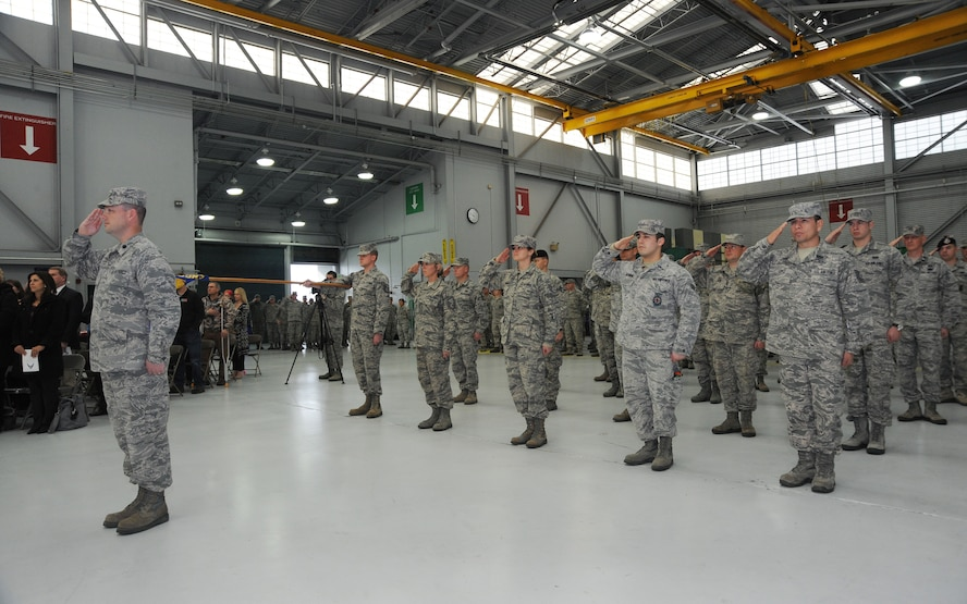 Airmen of the 142nd Fighter Wing Civil Engineer Squadron and Security Forces Squadron render a salute during their formal Demobilization Ceremony at the Portland Air National Guard Base, Ore., Dec. 7, 2014. The Airmen recently returned from overseas deployment assignments to support Operation Enduring Freedom. (U.S. Air National Guard photo by Tech. Sgt. John Hughel, 142nd Fighter Wing Public Affairs/Released)