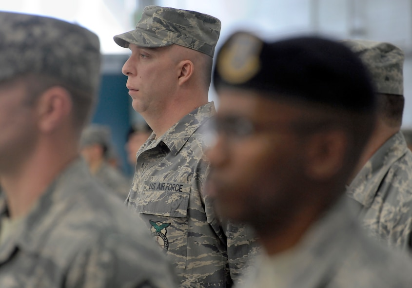 Oregon Master Sgt. Kyle Nelson, assigned to the 142nd Fighter Wing Civil Engineer Squadron, stands in formation and listens to remarks by Kate Brown, Oregon Sec. of State, during the Demobilization Ceremony for the 142nd Fighter Wing Civil Engineer Squadron and Security Forces Squadron at the Portland Air National Guard Base, Ore., Dec. 7, 2014. (U.S. Air National Guard photo by Tech. Sgt. John Hughel, 142nd Fighter Wing Public Affairs/Released)