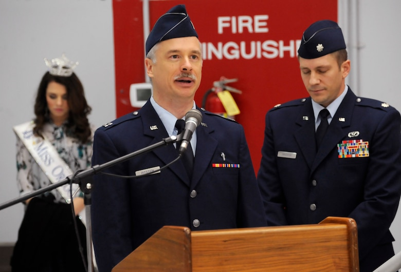 Capt. Rory Pitstick, 142nd Fighter Wing Chaplin, delivers the invocation at the Demobilization Ceremony for the 142nd Fighter Wing Civil Engineer Squadron and Security Forces Squadron at the Portland Air National Guard Base, Ore., Dec. 7, 2014. (U.S. Air National Guard photo by Tech. Sgt. John Hughel, 142nd Fighter Wing Public Affairs/Released))