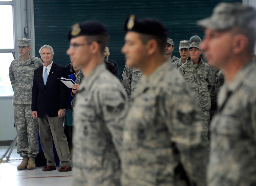 Maj. Gen. Daniel R. Hokanson, The Adjutant General, Oregon, and Oregon Governor John Kitzhaber, stand by for the Demobilization Ceremony for the 142nd Fighter Wing Civil Engineer Squadron and Security Forces Squadron at the Portland Air National Guard Base, Ore., Dec. 7, 2014. (U.S. Air National Guard photo by Tech. Sgt. John Hughel, 142nd Fighter Wing Public Affairs/Released)