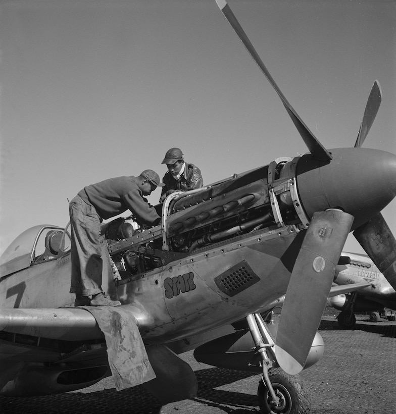 1st Lt. Roscoe Brown Jr. (right) and crew chief Marcellus G. Smith working on the engine of a 100th Fighter Squadron P-51 Mustang. On March 24, 1945, Brown shot down a German Me 262 jet fighter. (U.S. Air Force photo)