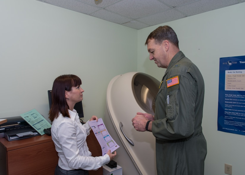 Wendy Wyatt, 628th Aerospace Medicine Squadron's nutritional program manager, briefs Brig. Gen. Kory Cornum, Air Mobility Command surgeon general, during his visit to the 628th Medical Group, Dec. 5, 2014, at Joint Base Charleston, S.C. While visiting the 628th MDG, Cornum coined several MDG Airmen, as well as notified those Airmen selected as AMC  Medical Service Award winners. (Courtesy photo / Maj. Julie Johnson)