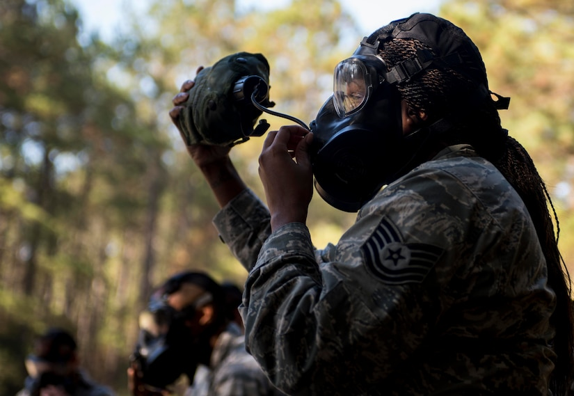Technical Sgt. Chiquita Frazier, 628th Logistics Readiness Squadron flight service center NCOIC, stays hydrated during a chemical, biological, radiological, nuclear and high-yield explosives training course Dec. 3, 2014, at Joint Base Charleston, S.C. After Air Force Basic military training, active-duty Airmen are required to go through CBRNE refresher training every two years. (U.S. Air Force photo/Senior Airman Marianique Santos)