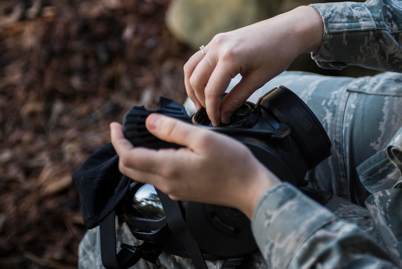 Senior Airman Gloria Davis-Phillips, 437th Maintenance Group maintenance data analyst, checks the seals on her gas mask during a chemical, biological, radiological, nuclear and high-yield explosives training course Dec. 3, 2014, at Joint Base Charleston, S.C. After Air Force Basic military training, active-duty Airmen are required to go through CBRNE refresher training every two years. (U.S. Air Force photo/Senior Airman Marianique Santos)