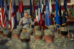 Defense Secretary Chuck Hagel addresses U.S. service members during a visit to Camp Beuhring, Kuwait, Dec. 8, 2014. DoD photo by Air Force Master Sgt. Adrian Cadiz