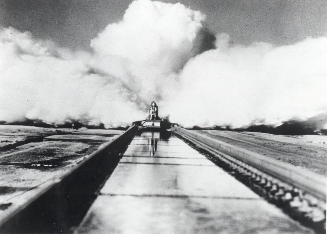 """On December 10, 1954, Col. John P. Stapp propelled down the Holloman High Speed Test Track aboard the Sonic Wind Rocket Sled 1 at a rate of 632 miles per hour, earning the title """"The Fastest Man on Earth."""" Stapp's experiment was the last human test at the HHSTT. His findings proved a pilot flying at 35,000 feet, going twice the speed of sound, could withstand the wind blast if he or she had to eject. (Courtesy Photo)"""