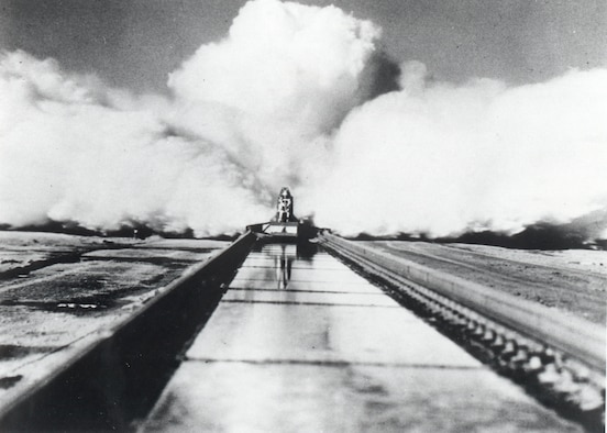 "On December 10, 1954, Col. John P. Stapp propelled down the Holloman High Speed Test Track aboard the Sonic Wind Rocket Sled 1 at a rate of 632 miles per hour, earning the title ""The Fastest Man on Earth."" Stapp's experiment was the last human test at the HHSTT. His findings proved a pilot flying at 35,000 feet, going twice the speed of sound, could withstand the wind blast if he or she had to eject. (Courtesy Photo)"