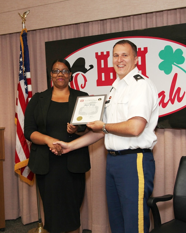 Lt. Col. Tom Woodie, Savannah District deputy commander, presents Paula Hanna, Family Readiness Network coordinator, a certificate of achievement in May for her accomplishments as the district's principal support liaison for deployed members and their families.