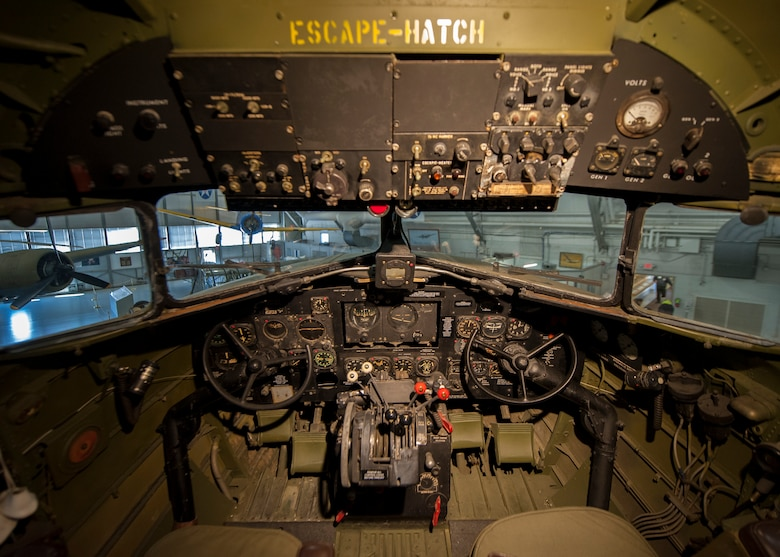"The cockpit of the C-47A Skytrain, the ""Turf and Sport Special,"" sits on display Nov. 15, 2014, inside the Air Mobility Command Museum on Dover Air Force Base, Del. This type of aircraft carried personnel and cargo, and in a combat role, towed troop-carrying gliders and dropped paratroopers into enemy territory. (U.S. Air Force photo/Airman 1st Class Zachary Cacicia)"