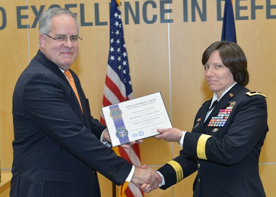 DIA Acting Director David Shedd presents Army Brig. Gen. Robin Fontes with her graduation certificate from the Joint Military Attaché School. Fontes will be the first female attaché assigned to India and the first general officer to serve as an attaché in India since the 1960s.