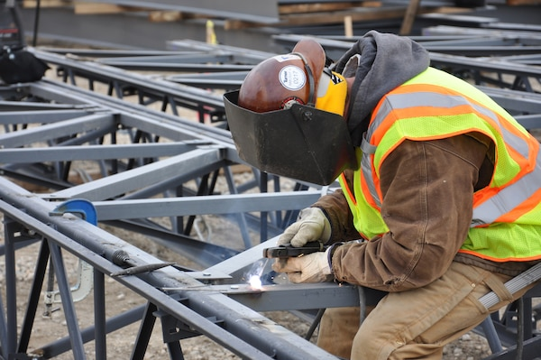 A contractor works on welding pieces of  steel trusses that will form the new fourth building of the National Museum of the United States Air Force near Dayton, Ohio.