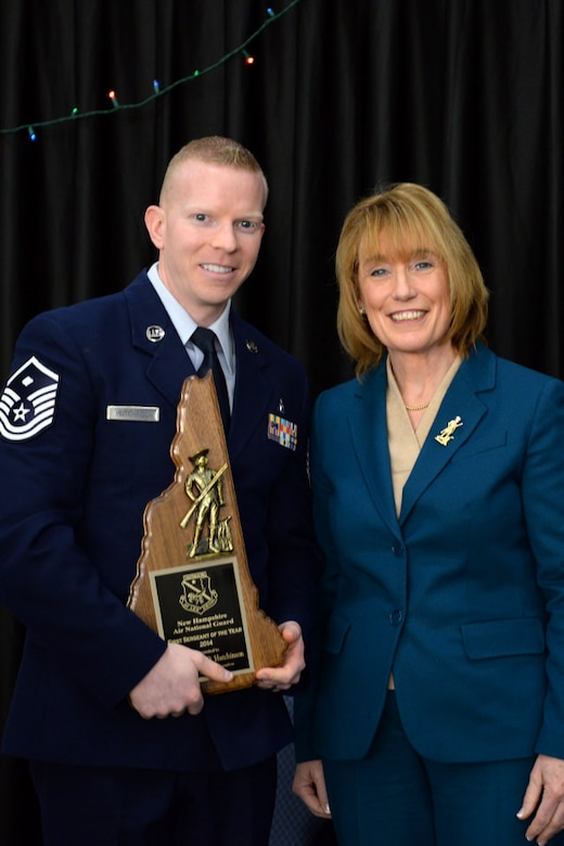 Master Sgt. Jeremy Hutchinson with the 157th Mission Support Group is presented the 157th Air Refueling Wing's 1st Sgt. of the Year award by N.H. Governor Maggie Hassan, Pease Air National Guard Base, N.H., Dec 7, 2014. (Air National Guard photo by Staff Sgt. Curtis J. Lenz/Released)