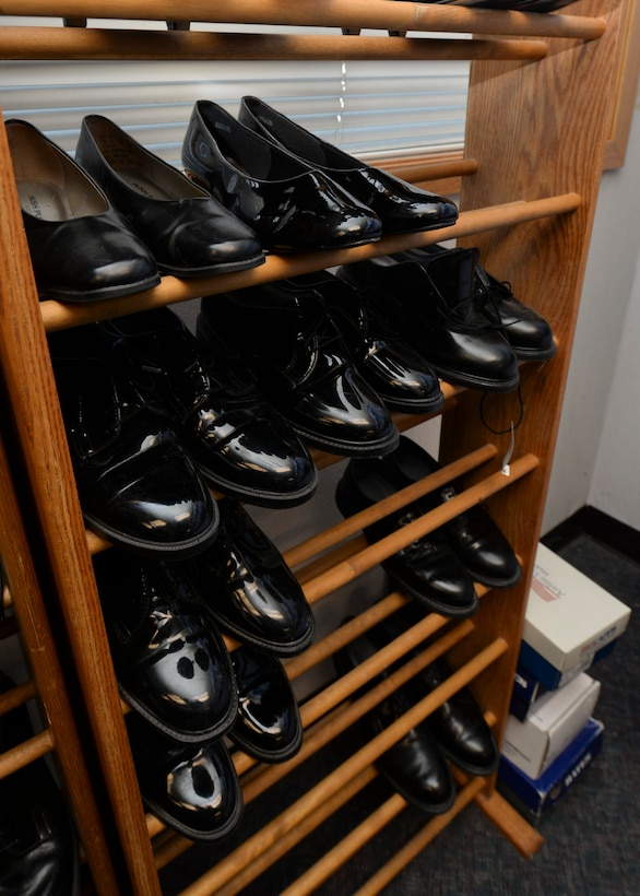 Serviceable shoes and boots of all sizes fill a rack to at the Diamond Mart on Ellsworth Air Force Base, S.D., Dec. 4, 2014. Due to the generous donations from active-duty and retired servicemembers, the Diamond Mart is able to provide an additional resource of uniformed clothing items for active-duty Airmen who may need replacement items. (U.S. Air Force photo by Senior Airman Anania Tekurio/Released)