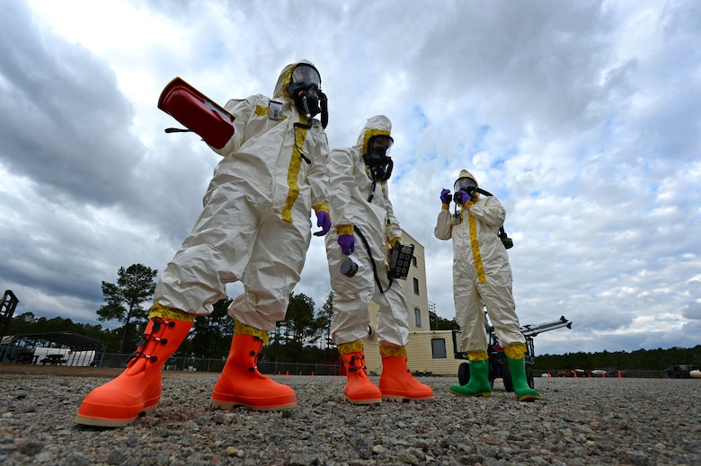 (From left) U.S. Air Force Senior Airmen Chantal Hogue and Lauren Yancey, 20th Civil Engineer Squadron emergency management apprentices, and Senior Airman Jordan Gagne, 20th Aerospace Medicine Squadron bioenvironmental engineering journeyman, participate in an integrated base emergency response capability training exercise at Shaw Air Force Base, S.C., Dec. 9, 2014.  The three Airmen were the initial entry team, the first to enter the simulated contaminated area to test for hazardous material. (U.S. Air Force photo by Airman 1st Class Jensen Stidham/Released)