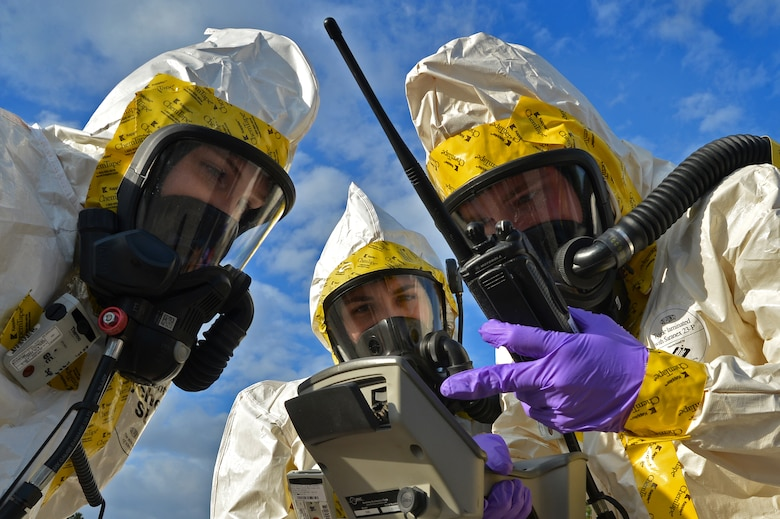 (From left) U.S. Air Force Senior Airman Lauren Yancey, and Chantal Hogue, 20th Civil Engineer Squadron emergency management apprentices, and Senior Airman Jordan Gagne, 20th Aerospace Medicine Squadron bioenvironmental engineering journeyman, assess their gages while checking for simulated hazardous chemicals during an integrated base emergency response capability training at Shaw Air Force Base, S.C., Dec. 9, 2014. The Airmen worked together to assess the spread of simulated chemicals while being evaluated on their performance. (U.S. Air Force photo by Staff Sgt. Kenny Holston/Released)