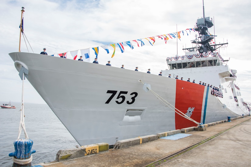 The crew of Coast Guard Cutter Hamilton take up positions around the deck of the cutter after the vessel's commissioning ceremony in Charleston, Dec. 6, 2014. Hamilton is the Coast Guard's fourth 418-foot Legend-Class National Security Cutter. (Coast Guard photo by Petty Officer 1st Class Stephen Lehmann)