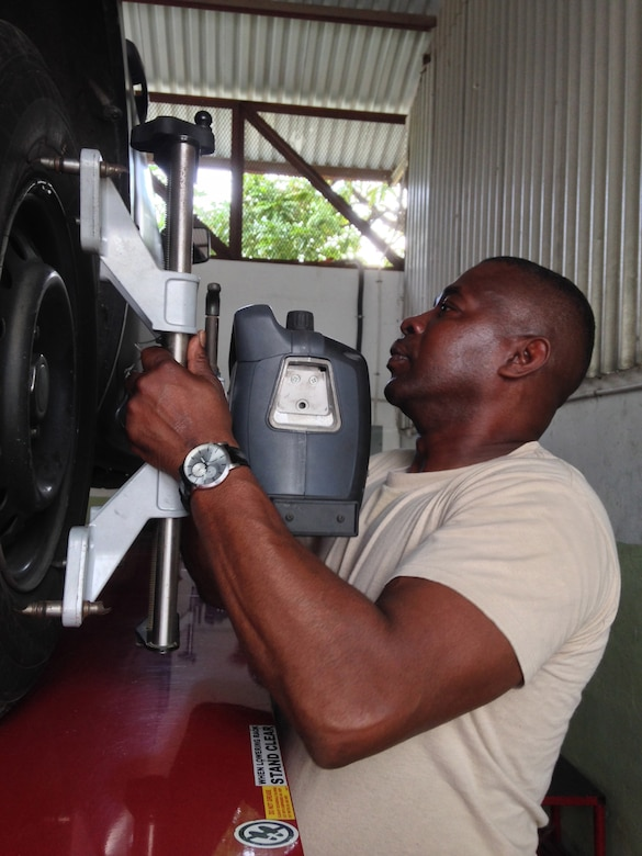 Master Sgt. Jesse Evans fixes a JDF truck on the second day of a weeklong subject matter expert exchange. Expert vehicle mechanic soldiers and airmen from the D.C. National Guard are here to share best practices with their JDF counterparts National Guard Bureau's State Partnership Program. Evans is a D.C. Army National Guard surface maintenance inspector supervisor. (U.S. Air National Guard photo by Capt. Renee Lee)