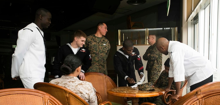 Marines and sailors gather to discuss their views on diversity Dec. 2 during Diversity Observance Day on Camp Hansen. The event participants were chosen based on their different backgrounds, and discussed what diversity meant to them. The event marked the first Diversity Observance Day held at III Marine Expeditionary Force, and it is planned to be an annual event, according to Master Gunnery Sgt. Rafika O. Vann, from Brooklyn, New York. Vann is the III MEF Equal Opportunity Adviser.