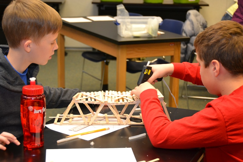 WINCHESTER Va. - Students at the STARBASE Academy build a popsicle bridge.