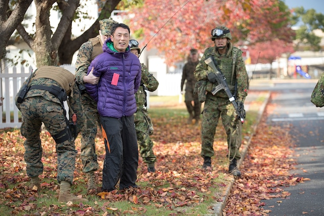 Provost Marshal's Office Marines and Japan Ground Self-Defense Force troops conducted riot control training in addition to capturing and detaining intruders during Exercise Keen Sword aboard Marine Corps Air Station Iwakuni, Japan, Nov. 18, 2014. Keen Sword is a routine force protection exercise designed to strengthen the relationship and interoperability between the air station and JGSDF forces.
