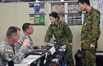 CAMP ASAKA, Japan (Dec. 11, 2014) - Chief Warrant Officer 3 Onix Vazquez, a petroleum system technician with the 593rd Expeditionary Sustainment Command, works with members of the Japan Ground Self-Defense Force during Yama Sakura, an annual bilateral command post exercise between Japan and the U.S. The exercise ran from Dec. 2-14 on Camp Asaka.