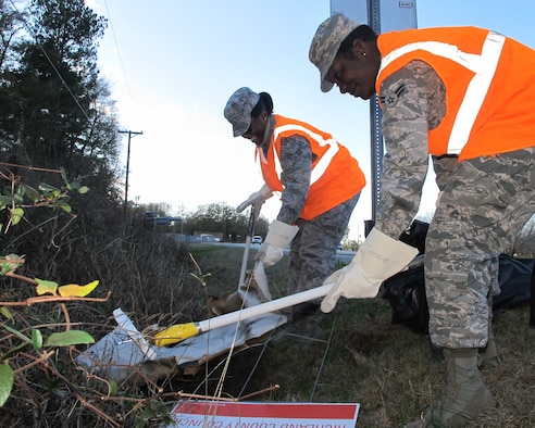 Senior Airman Renae McNease (left) and Airman 1st Class Angel Knox, emergency management technicians with the 169th Civil Engineer Squadron, pick up trash during an Adopt-a-Highway clean-up held Dec. 11, 2014. The South Carolina Air National Guard's Environmental Office partners with the South Carolina Department of Transportation to pick up garbage outside of McEntire Joint National Guard Base four times a year and Airmen on base volunteer their efforts to keep the stretch of highway outside of the main gate clean.  (U.S. Air National Guard photo by 2nd Lt. Stephen Hudson/Released)