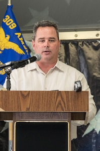 Robert A. Lewis, 575th Aircraft Maintenance Squadron director, addresses the crowd for the first time as the 575th AMXS dedicated squadron director during an activation ceremony Dec. 11 at Joint Base San Antonio-Randolph. The 575th AMXS is a geographically separate unit assigned to the 309th Aircraft Maintenance Group, Ogden Air Logistics Complex Hill Air Force Base, Utah. The squadron is responsible for depot level maintenance, restoration and modification of over 500 T-38 Talon aircraft for the United States Air Force and Navy. (U.S. Air Force photo by Johnny Saldivar)