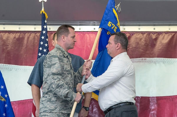 Brig. Gen. Carl Buhler, Ogden Air Logistics Complex commander, passes the guidon to  Robert A. Lewis, 575th Aircraft Maintenance Squadron director, the 575th Aircraft Maintenance Squadron guidon as part of the 575th AMXS activation ceremony Dec. 11 at Joint Base San Antonio-Randolph. The 575th AMXS is a geographically separate unit assigned to the 309th Aircraft Maintenance Group, Ogden Air Logistics Complex Hill Air Force Base, Utah. The squadron is responsible for depot level maintenance, restoration and modification of over 500 T-38 Talon aircraft for the United States Air Force and Navy. (U.S. Air Force photo by Johnny Saldivar)