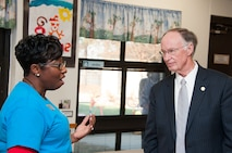 Alabama Governor Robert Bentley speaks with Mary Smith, Gunter Child Development Center child and youth program assistant, Dec. 10.  The governor visited the CDC to highlight Alabama's First Class Voluntary Pre-Kindergarten Program.  Bentley announced a $17.5 million federal grant to Alabama to support Alabama communities in providing high-quality preschool programs.  A portion of those funds will support the CDCs at both Maxwell and Gunter.  The funds will be used to help pay teachers, facilitate field trips and improve playground equipment. (Air Force Photo by Henry Hancock/Cleared)