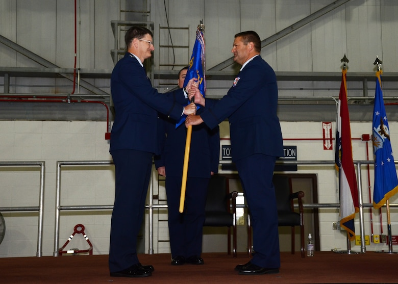 Lt. Col. Michael Jurries accepts the 131st Mission Support Group guidon from Col. Michael Francis, 131st Bomb Wing Commander, during Jurries's Assumption of Command ceremony at Whiteman Air Force Base, Mo., Dec. 7, 2014.  (U.S. Air National Guard photo by Airman 1st Class Halley Burgess)