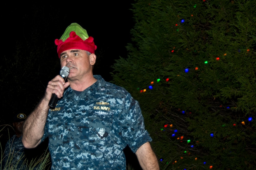 U.S. Navy Capt. Timothy Sparks, Joint Base Charleston deputy commander, conveys his holiday greetings during the annual Christmas tree lighting ceremony Dec. 4, 2014, on Joint Base Charleston - Weapons Station, S.C. The tree lighting is an annual tradition held at both the Air Base and Weapons Station to kick off the holiday season. (U.S. Air Force photo/Senior Airman Melissa Goslin)