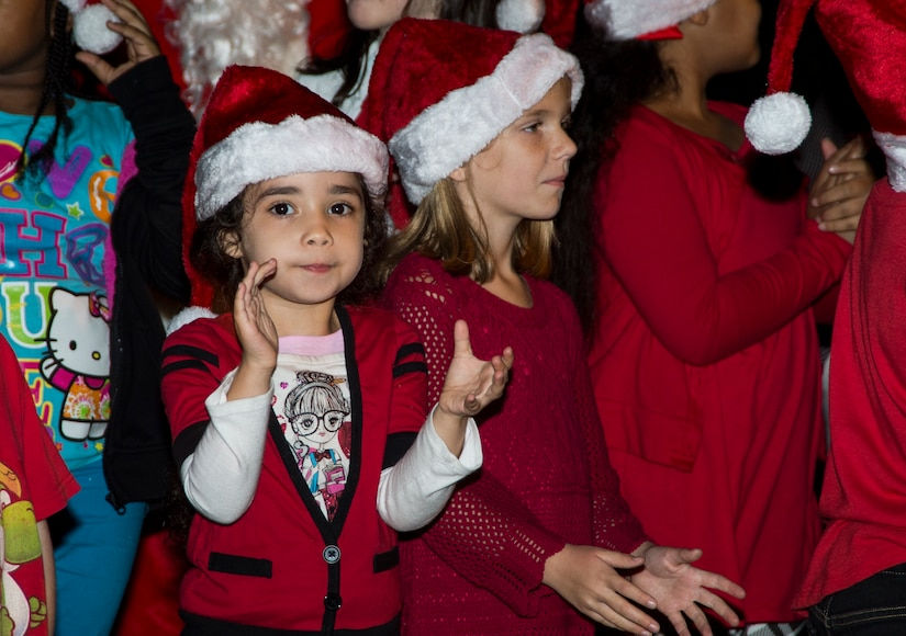 Children from the Joint Base Charleston Youth Center sing Christmas carols during the annual Christmas tree lighting ceremony Dec. 4, 2014, on JB Charleston - Weapons Station, S.C. The tree lighting is an annual tradition held at both the Air Base and Weapons Station to kick off the holiday season. (U.S. Air Force photo/Senior Airman Melissa Goslin)